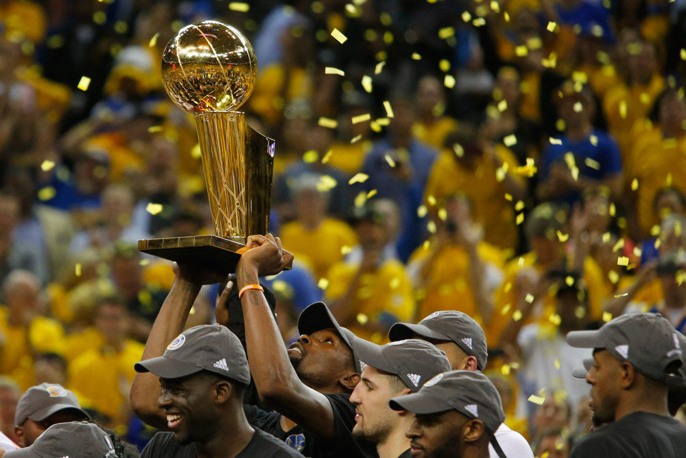 Kevin Durant takes a long look at his first Larry O'Brien NBA Championship Trophy, his first since joining the league in 2007. Ramin Rahimian for ESPN