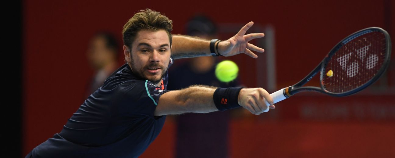Stan Wawrinka of Switzerland hits a return during his men's singles second round match against Canada's Denis Shapovalov at the Japan Open tennis championships in Tokyo on October 3, 2018. TOSHIFUMI KITAMURA/AFP/Getty Images