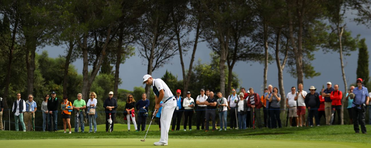 Sergio Garcia putts amid darkening skies during the Andalucia Masters as the Real Club Valderrama.