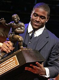 Reggie Bush with the Heisman Trophy