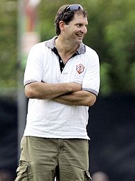 Former Cleveland Browns quarterback Bernie Kosar laughs during a visit to the Cleveland Browns training camp, Thursday, Aug. 16, 2007, in Berea, Ohio.
