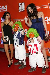 Kourtney and Chloe Kardashian with Oompa Loompas