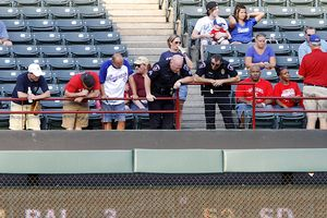 Texas Rangers' fan falls