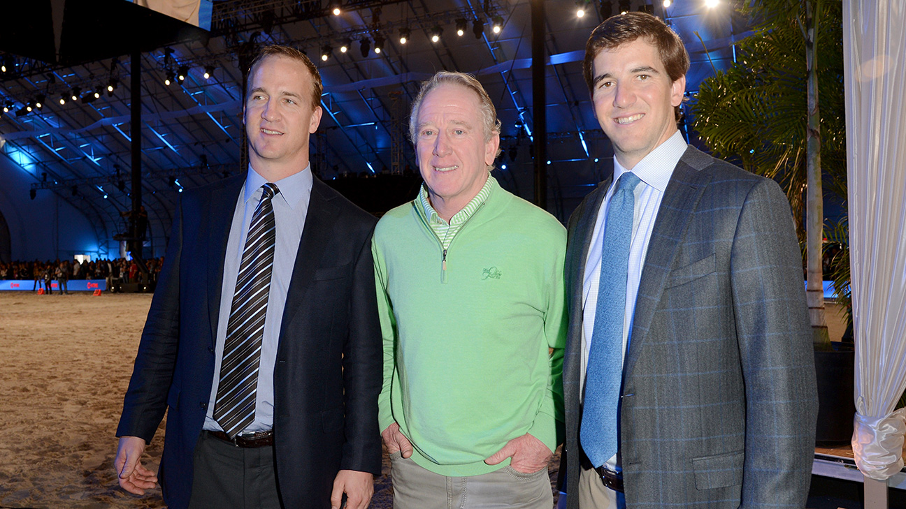 Archie Manning's sons Peyton (left) and Eli (right) have each led their teams to victories in two Super Bowls. Jason Merritt/Getty Images For DirecTV