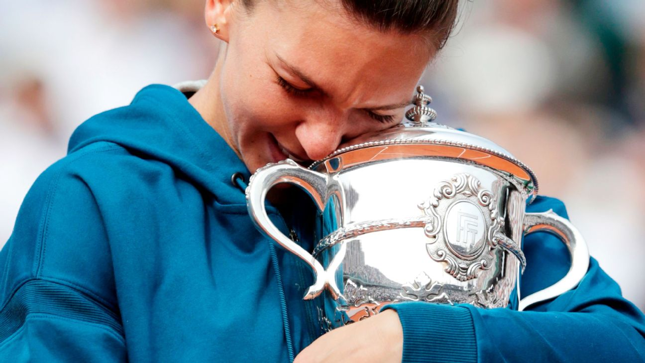 Romania's Simona Halep celebrates with her trophy after winning the French Open final against Sloane Stephens. THOMAS SAMSON/AFP/Getty Images