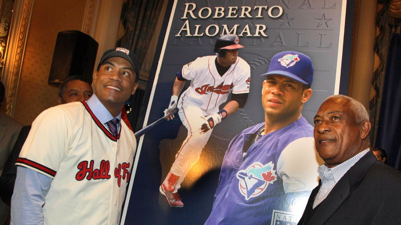 Twelve-time All-Star Roberto Alomar (left) was inducted into the Hall of Fame in 2011 and his father, Sandy, shared in the celebration. AP Photo/Richard Drew