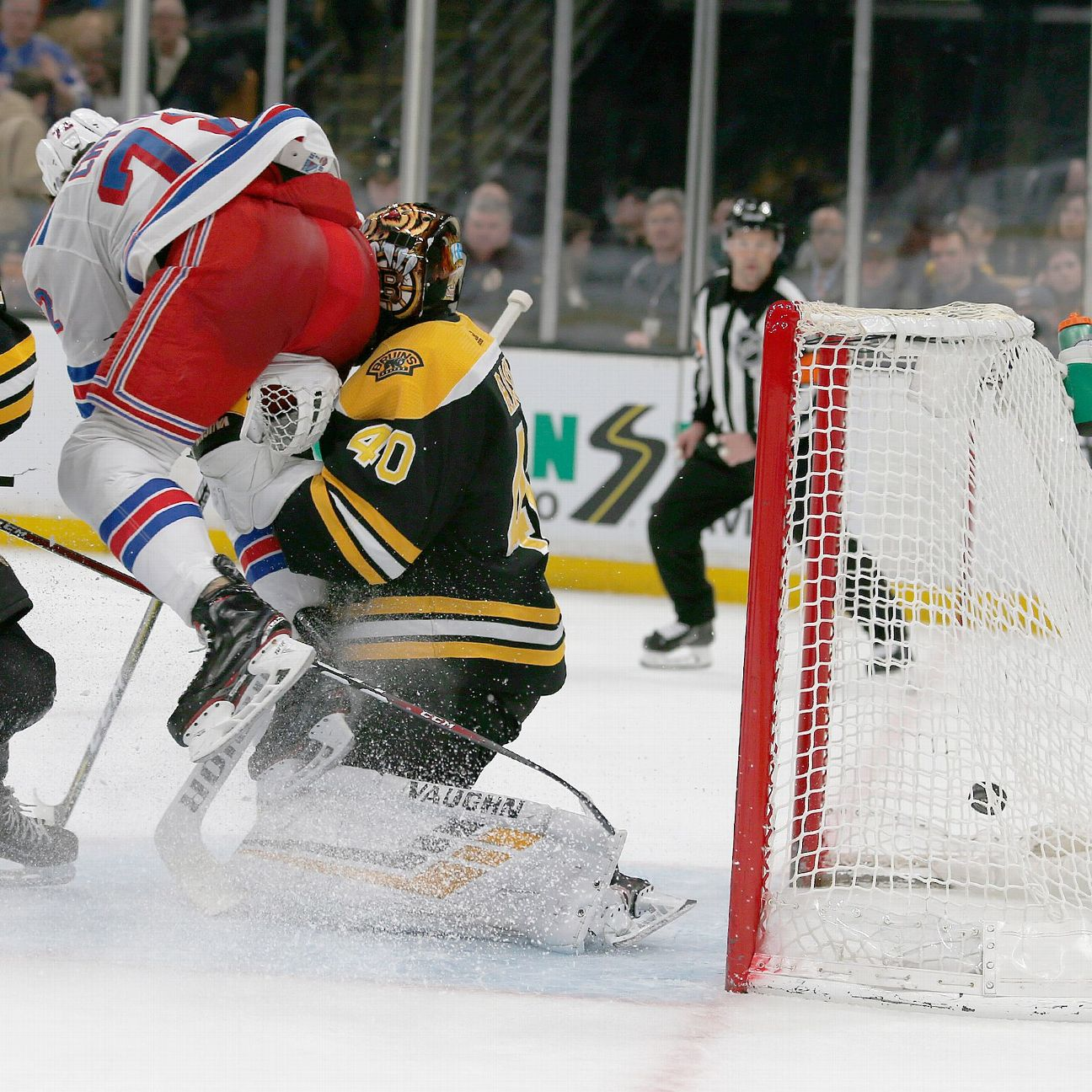 Bruins goalie Tuukka Rask suffered a concussion on a hard collision with Rangers forward Filip Chytil and was helped off the ice late in the opening period.