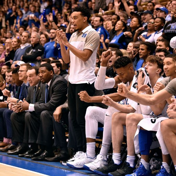 Injured point guard Tre Jones stands to cheer on his Duke teammates during Saturday's win over previously undefeated Virginia. Grant Halverson/Getty Images