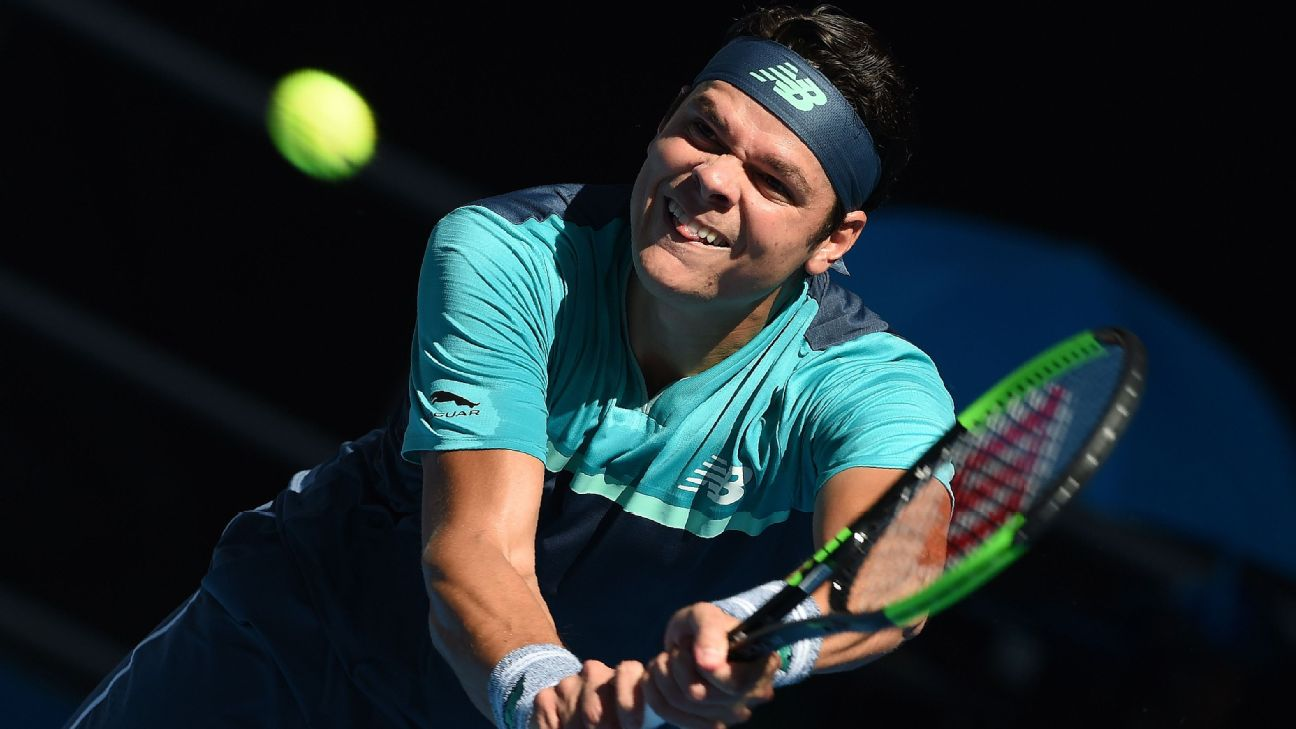 Milos Raonic of Canada hits a return in his third round match at the 2019 Australian Open.