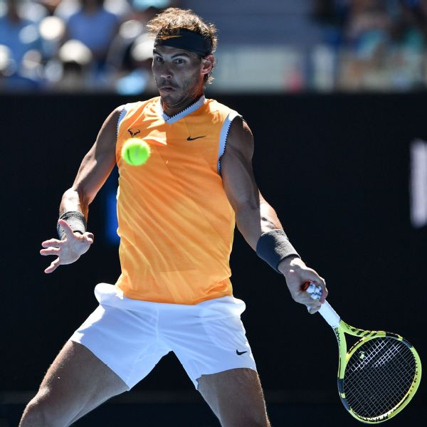 Rafael Nadal hits a return against Tomas Berdych at the Australian Open on Sunday.