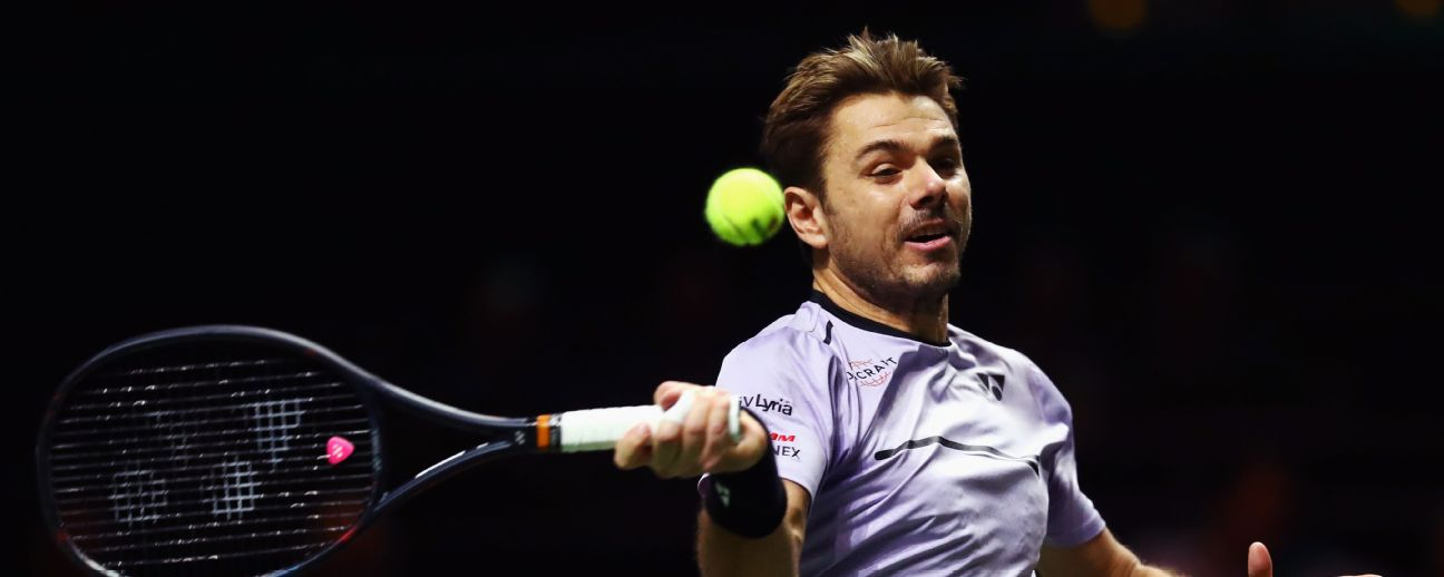 Stan Wawrinka of Switzerland returns a forehand against Benoit Paire of France during day one of the ABN AMRO World Tennis Tournament at Rotterdam. Dean Mouhtaropoulos/Getty Images