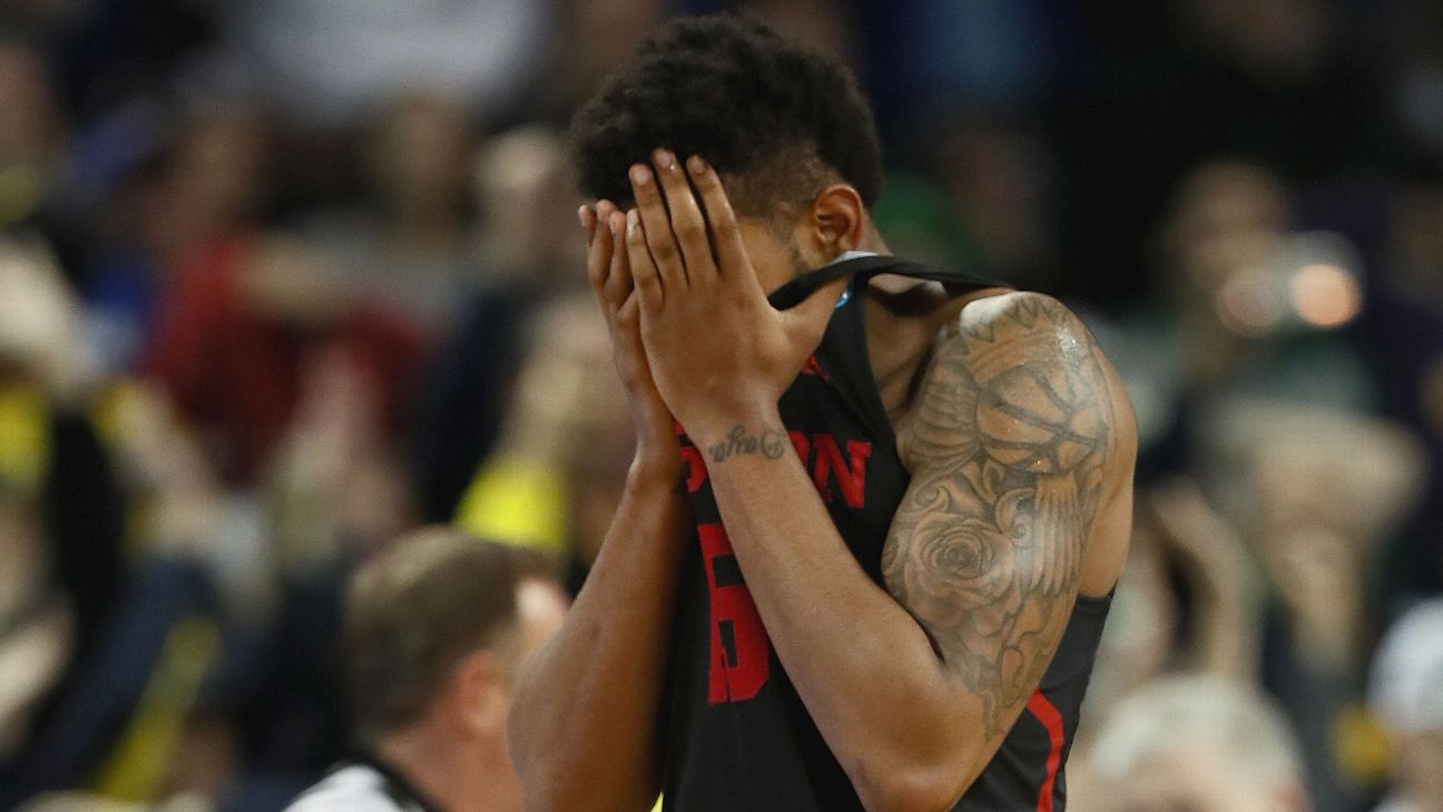 Last year's buzzer-beater loss to Michigan gave Houston fans heartbreak that they haven't had since the Phi Slamma Jamma days. Jamie Squire/Getty Images