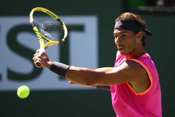 Rafael Nadal plays a backhand against Filip Krajinovic en route to a win in straight sets Wednesday to reach the quarterfinals of the BNP Paribas Open at Indian Wells. Clive Brunskill/Getty Images
