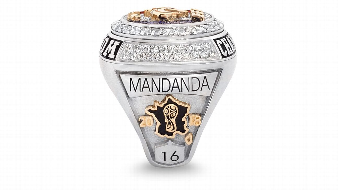 In a style similar to that of NBA rings, one side was personalized with the player's name and number.