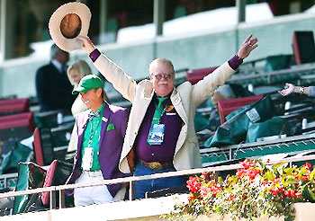 Steve Coburn, co-owner of California Chrome, waves to fans at Belmont Park on Belmont Stakes Day.